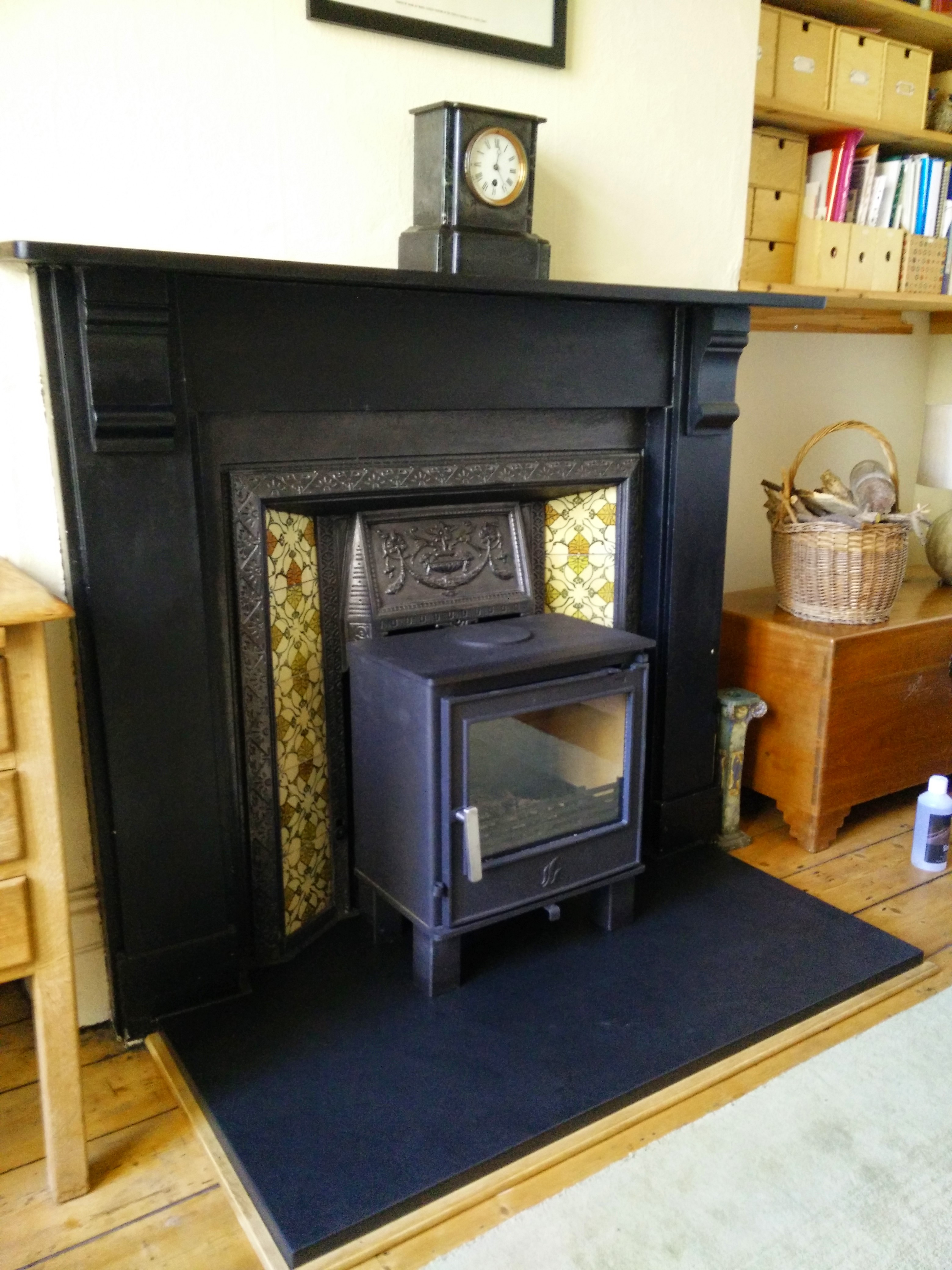 A larger hearth fitted to enable the fitting of this  Malvern in front of the original fireplace